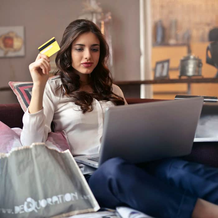 Customer shopping online and purchasing goods with credit card